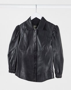 puff sleeve leather top in black-White