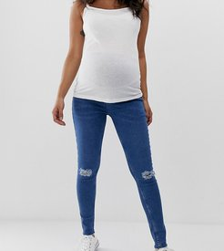 over bump ripped skinny jeans in blue