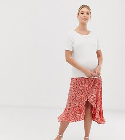 side button ruffle midi skirt in red floral pattern