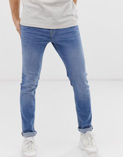 skinny jeans in mid blue wash-Blues