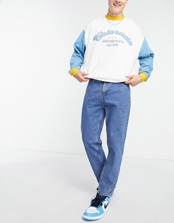 slim cropped jeans in mid blue wash-Blues