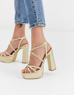 strap up platform high heel in gold