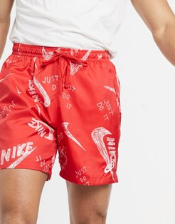 all over logo print woven shorts in red