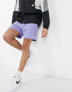 Just Do It washed shorts in purple