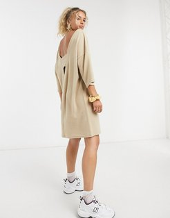 midi dress with cut out in beige