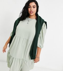 midi smock dress with tiering in sage green