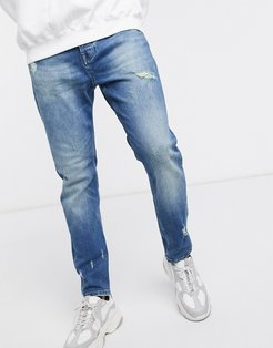 cropped distressed jeans in light blue