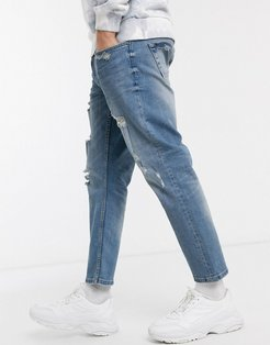 cropped fit destroyed jeans in light blue
