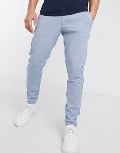 slim tapered fit pants in light blue