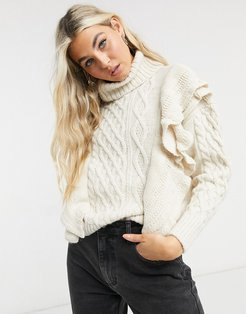 sweater with high neck and ruffle detail in cream-White