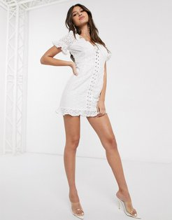 lace up front broderie mini dress in white