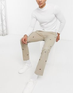 slim fit all over horse embroidery cotton stretch twill chinos in khaki tan