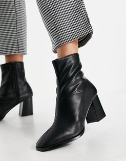 Freya heeled ankle boots in black faux leather