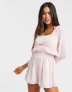 plunge lace trim long sleeve beach romper in pink