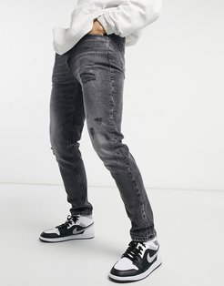 slim jeans with rips in washed black