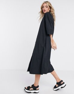 Femme shirt dress with pleated back in black