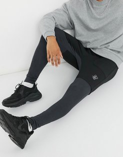 advanced tech sweatpants in black and gray