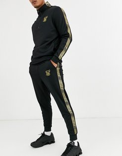 skinny sweatpants in black with gold logo