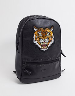 backpack in black with tiger print