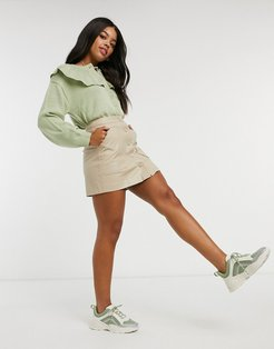 faux leather skirt with front pockets in stone