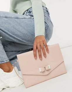 Harliee bow envelope clutch bag in pink