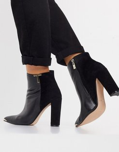 Qinala heeled ankle boot with T branding detail in black