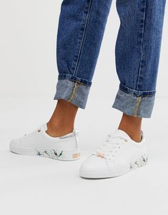 white leather floral sole sneakers