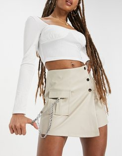 asymmetric buckle detail mini skirt in white