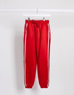 stripe side seam detail oversized sweatpants in red