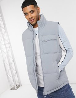 recycled puffer vest in blue