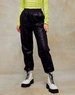 faux leather quilted sweatpants in black