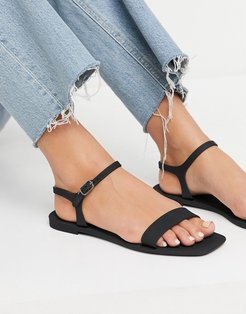 jelly sandals in black-Clear