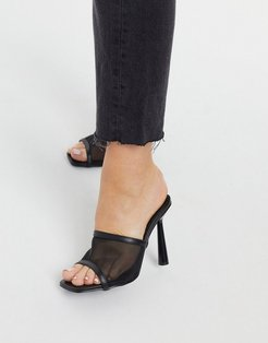 stiletto heeled mule with high vamp in black