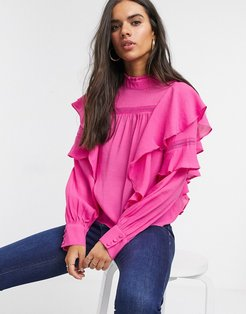 blouse with high neck and ruffle trim in pink