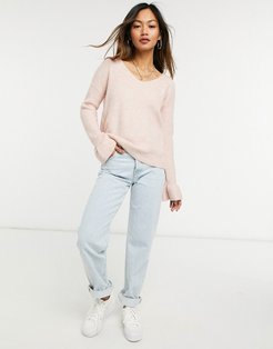 sweater with v neck and ruffle sleeve edge in pink