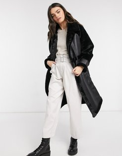 longline oversized faux fur coat with paneled detail in black