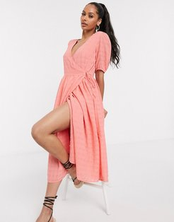 wrap midi dress with puff sleeve in textured peach-Pink