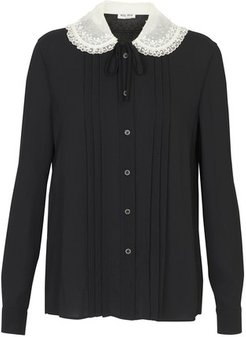 Blouse with laced collar