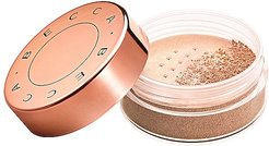 Champagne Pop Collector Glow Dust Highlighter in Champagne Pop.