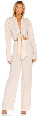 The Liana Jumpsuit in Beige. - size L (also in M, S, XL, XS)