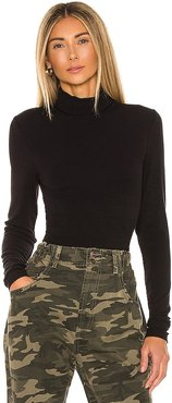 Essential Turtleneck in Black. - size L (also in M, S, XS)