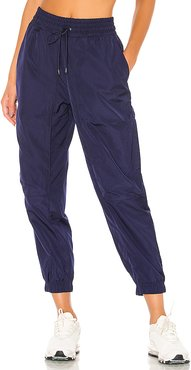 NSW Tech Pack Woven Pant in Navy. - size S (also in L)