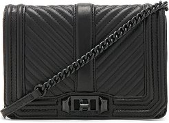 Chevron Quilted Small Love Crossbody Bag in Black.