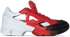 X Raf Simons red and black Ozweego cut out sneakers