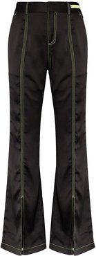 flared contrast-stitch trousers - Black