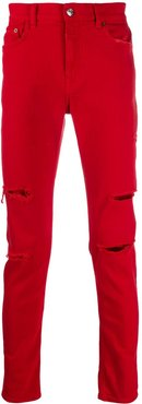 distressed slim-fit jeans - Red