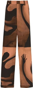 x Homecoming Tunde photo print trousers - Brown