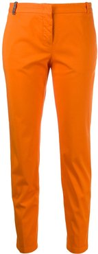 brass-embellished tapered trousers - ORANGE