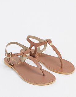 leather t-bar flat sandals in tan