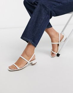 Candidly low heel sandal with tubular strap in white